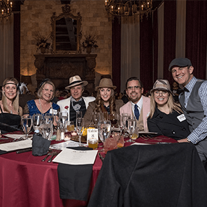 Orlando Murder Mystery party guests at the table