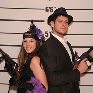 Orlando Murder Mystery party guests pose for mugshots